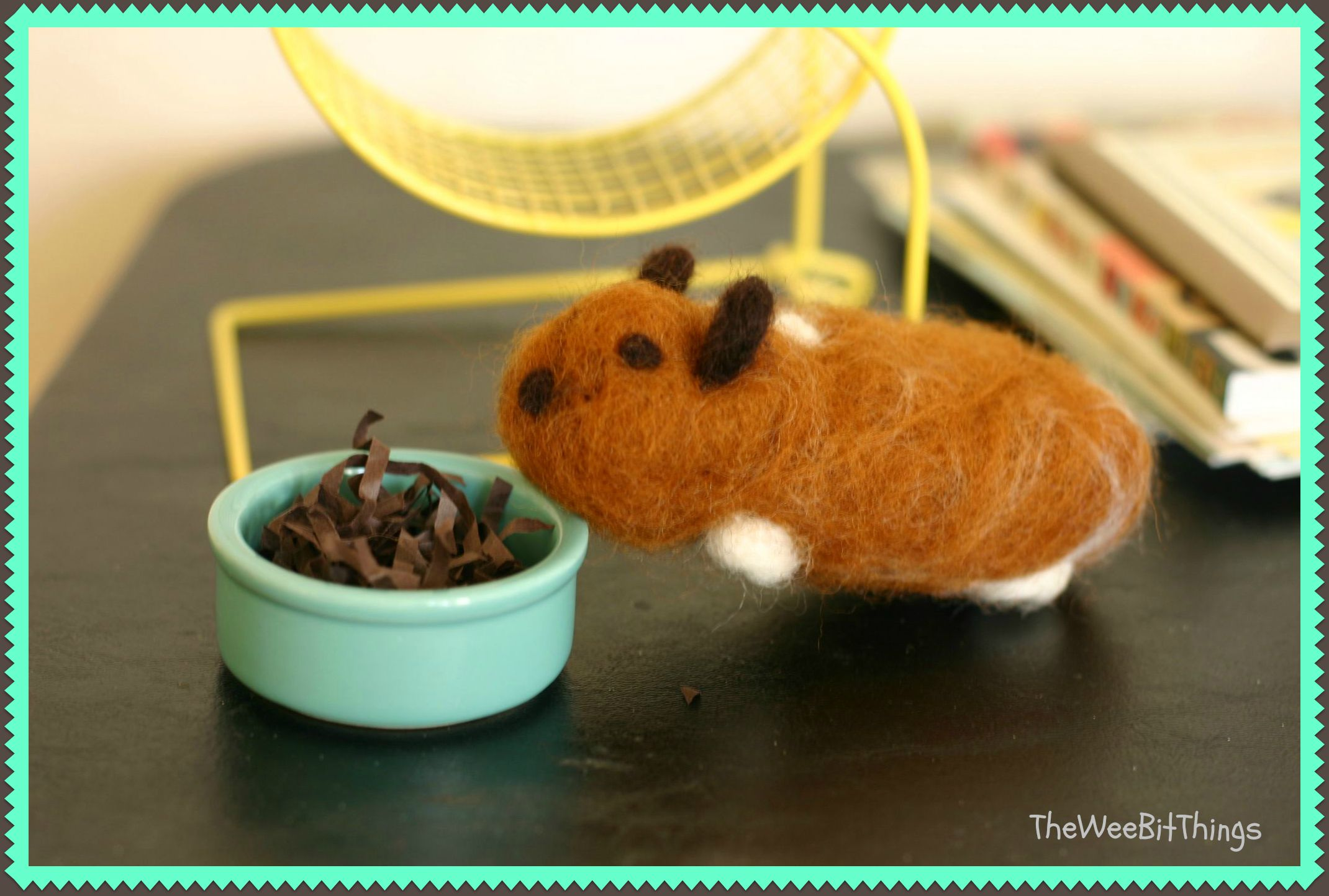 Image of handmade wool felt hamster eating out of pretend food bowl