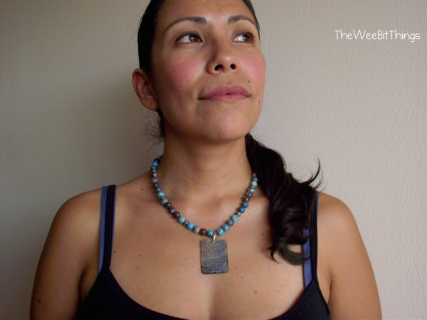 Model wearing blue beaded necklace