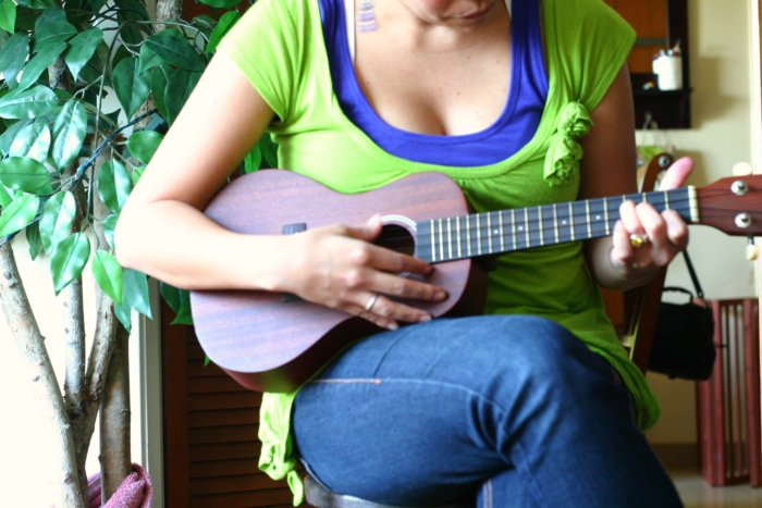 image of someone practicing with an ukulele