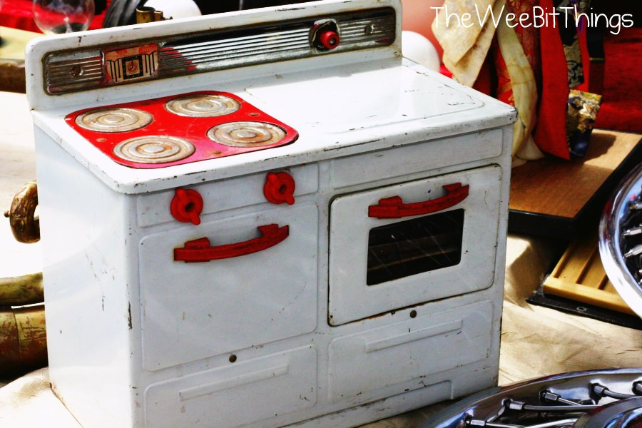 vintage toy stove in classic red and white